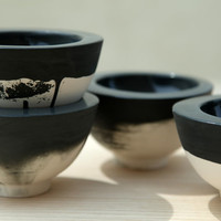 Hand made ceramic bowl in black and white with glossy glaze. Urban and modern look.
