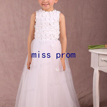 Beautiful flower girl dress with small flowers made of tulle