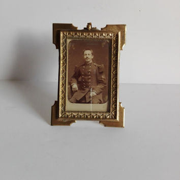 Old french photo frame ,on carved brass and  glass.