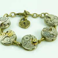 Industrial SteamPunk Neo-Victorian Bracelet with vintage watch movement and heart lock by Victorianfolly