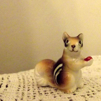 Vintage small squirrel figurine carrying a by DollyTopsyVintage