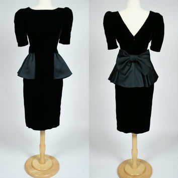 1980's black velvet wiggle dress with satin peplum and big bow deep V back short sleeve cocktail formal event gown size small medium 6, 8