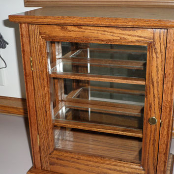 Miniature curio or display cabinet.