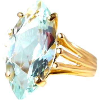 Estate marquise cut aquamarine ring set on a heavy 18K solid gold band Stamped fine jewelry