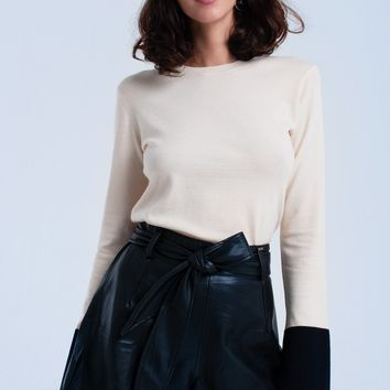 Beige sweater with black cuffs
