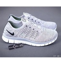 NIKE knitting flying line casual sports shoes White gray