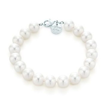 Tiffany & Co. -  Pearl bracelet with sterling silver clasp and decorative tag.