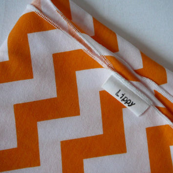 Orange chevron blanket. Swaddler type, stretchy knit. Size- 31 by 40 inches. (Made by lippybrand)