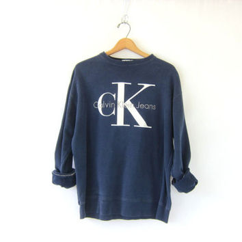 vintage CK Calvin Klein sweatshirt. navy blue pullover sweater. preppy revival top