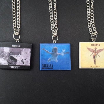 Nirvana album necklaces made from polymer clay