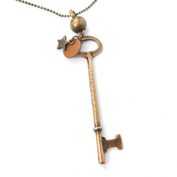 Long Skeleton Key and Star Shaped Pendant Necklace in Brass | DOTOLY