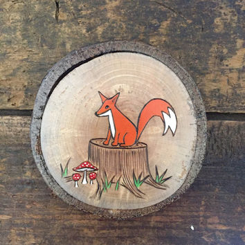 Wood burned and painted fox on a tree stump with mushrooms. Woodland wall hanging, ornament or magnet