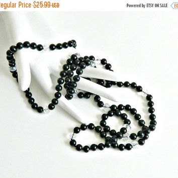 SALE Vintage Long Black Onyx Necklace. Hand Knotted Black Beaded Necklace. Clear Crystal Faceted Beads.