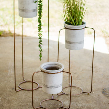 Set Of 3 Copper Finish Metal Stands With White Wash Pots