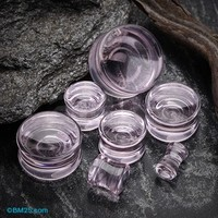 A Pair of Concave Transparent Glass Ear Gauge Plug