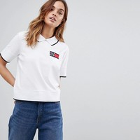Tommy Hilfiger Crop Polo Shirt With Racing Flag Logo at asos.com