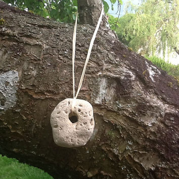 Hag stone hanging decoration, witch stone, holey stone, good health amulet, good luck charm, pagan decoration or Yule tree decoration