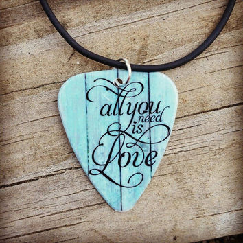 All you need is LOVE guitar pick on black necklace with turquoise wood background hearts- Gorgeous and Unique!