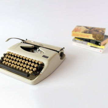 1960s Serviced Cream Adler Tippa Portable Manual Typewriter. Includes Carry Case and Ribbon.