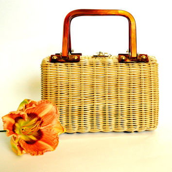 1960's Wicker purse with brown Lucite handles.