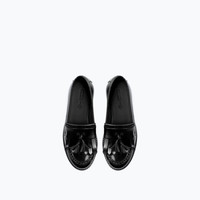 Track soled leather tassel moccasins