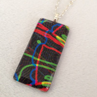 Original artwork glass tile necklace - 1x2in rectangle - black, red, green, yellow, blue