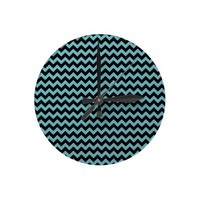Blue Curacao And Black Zigzag Chevron Pattern Round Clock from Zazzle.com