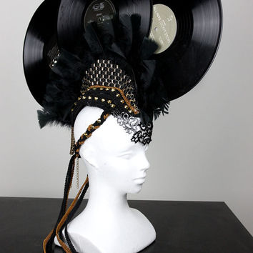Rock with U - Feather Record and Studded Mohawk Headdress with ribbon and jewelry