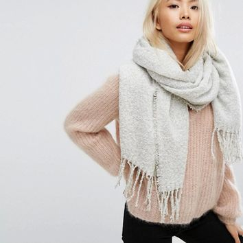 Stitch & Pieces Boucle Knitted Scarf with Tassles in Light Gray at asos.com