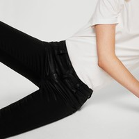 Coated skinny gloss jeans - Women | MANGO USA