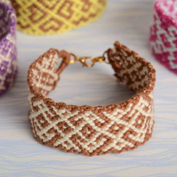 Handmade braided friendship bracelet made of floss thread white and brown