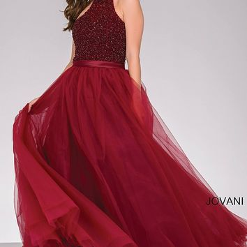 Burgundy long sleeveless beaded high neckline bodice ballgown with tulle skirt.