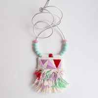 Textile pendant necklace geometric hand embroidered using red, pinks, cream and mint green on long silver leather cord with glass beads
