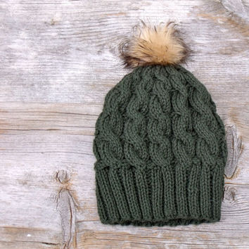 Women's Slouchy Cable Knit Beanie Hat in Deep Forest Green with a Camel and Brown Faux Fur Pom Pom