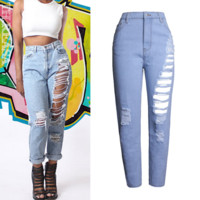 The new fashion hot bursts of women's holes cuddle loose loose pants