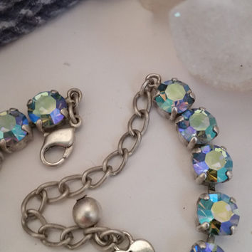swarovski crystal bracelet in matte silver finish, with aquamarine ab stones. #136.