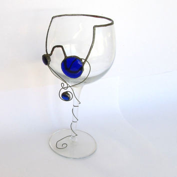 Wine glass recycled using stained glass technique. Clear glass with blue glass nuggets.