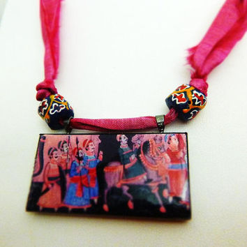 Royal Procession  - Indian Folk art Clay Tile pendant on Bright pink Sari silk ribbon with Sand Cast beads.