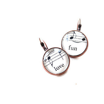Sheet music earrings handmade with vintage sheet music under glass.  Love fun words. Gift wrapped and ready to ship