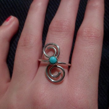 Authentic Navajo,Native American,Southwestern,sterling silver spirals sleeping beauty turquoise ring. Size 8 1/4