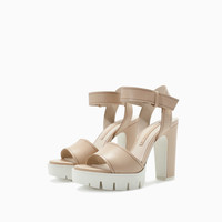 LEATHER SANDAL WITH TRACK HEEL