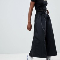 ASOS DESIGN wide leg culottes in sporty fabric with belt at asos.com
