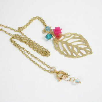 Charm necklace gold plated with Swarovski crystals and resin flower