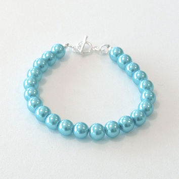 Bracelet with sky blue 8mm pearl glass beads and a silver toggle clasp.