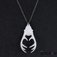 "The ""Remember"" necklace in white - An antler necklace with a hidden heart within its curves."