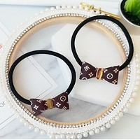 LV classic fabric small bow hair band rubber band Classic Elegant coffee (a pair)