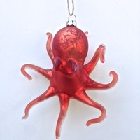 This shimmering Octopus ornament is amazingly beautiful and unique! With it's outstretched, curling tentacles and gorgeous spotted faux-mercury glass finish, it will add a touch of undersea charm to your decorations as it sparkles and shines under the ligh