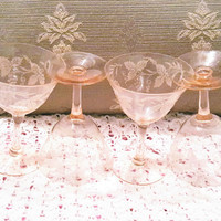 A Set of Four Pink Depression Glass Champagne Coupe Sherbert Stem Glasses With Floral Etching