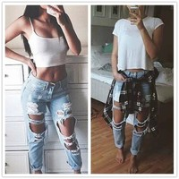 Torn and Distressed Blue Jeans