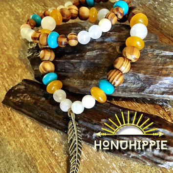 Boho hippie jewelry, beaded feather bracelet